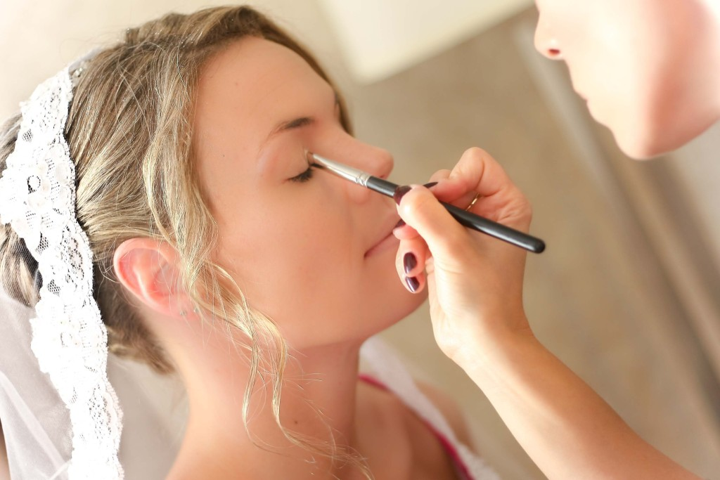 Bride-getting-her-makeup-professionally-applied